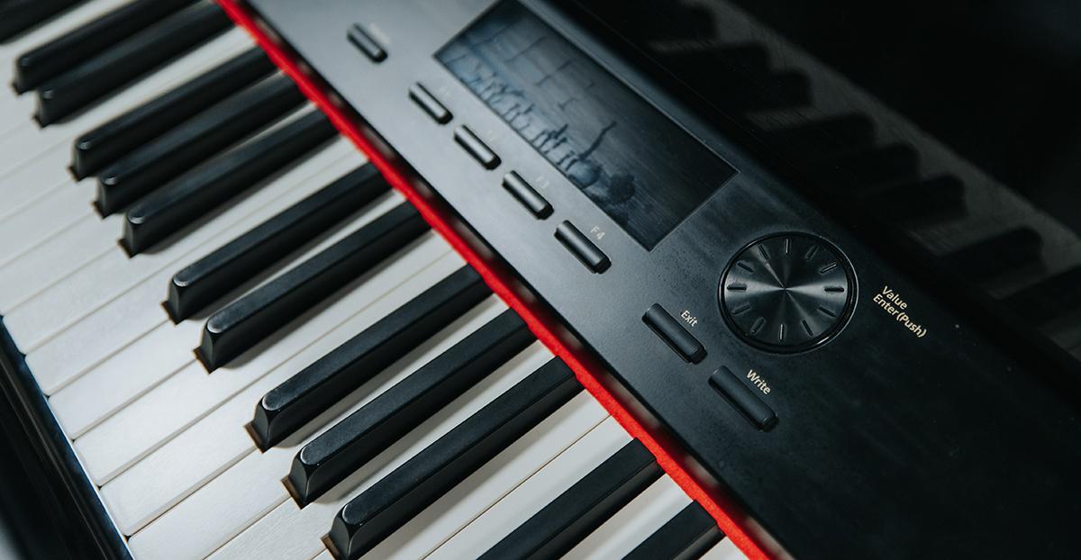 Close-up of digital piano keyboard.