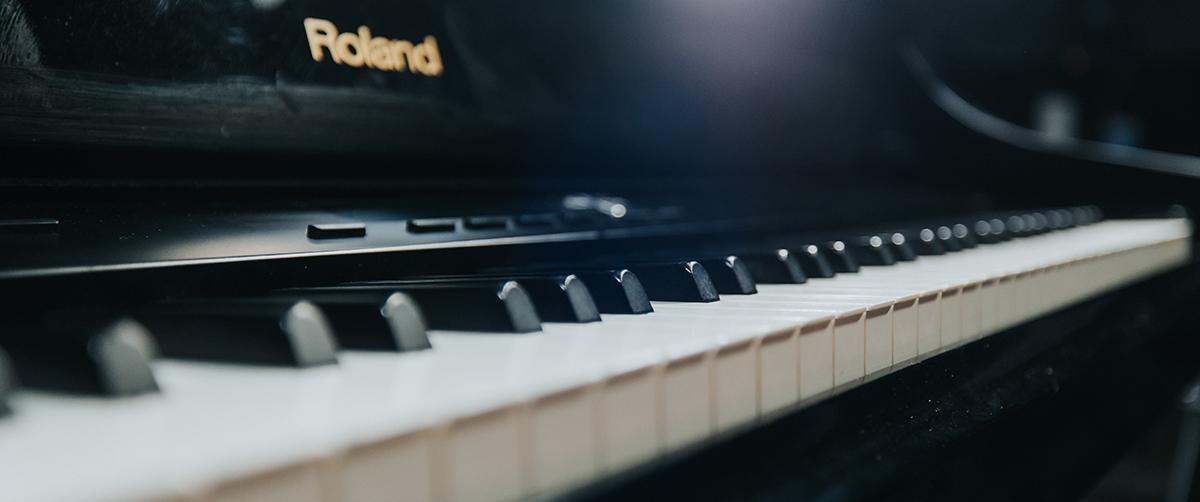Close-up angled photo of Roland keyboard keys.