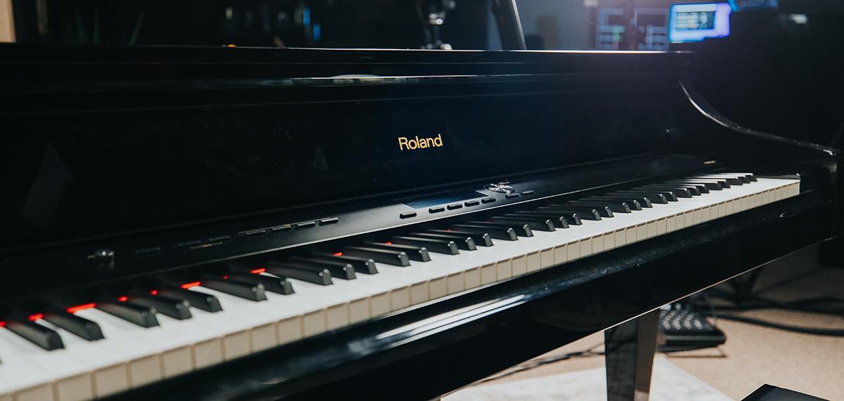 Angled photo of Roland V-Grand piano in Pianote studio.