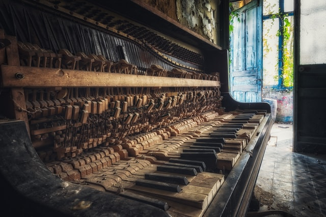 Very old and battered upright piano keyboard.