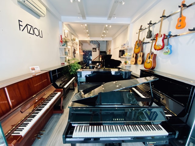 A music store with pianos and guitars.